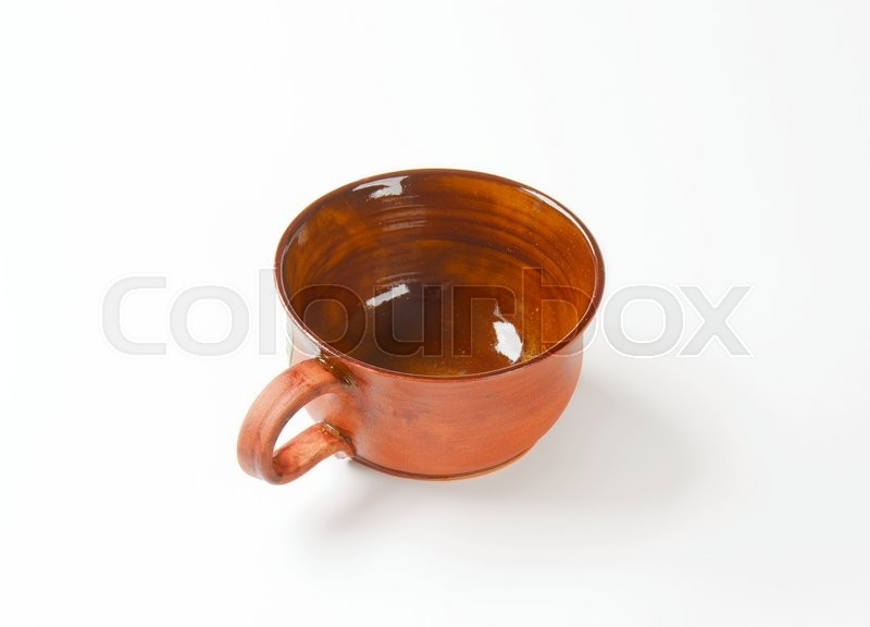 Stock image of 'Pottery soup mug with handle'