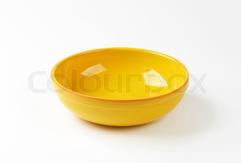 Stock image of 'Empty round yellow ceramic bowl'