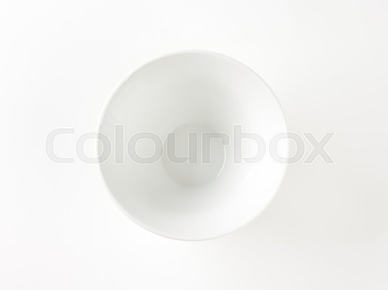 Stock image of 'Empty deep white snack bowl, ribbed on the outside'