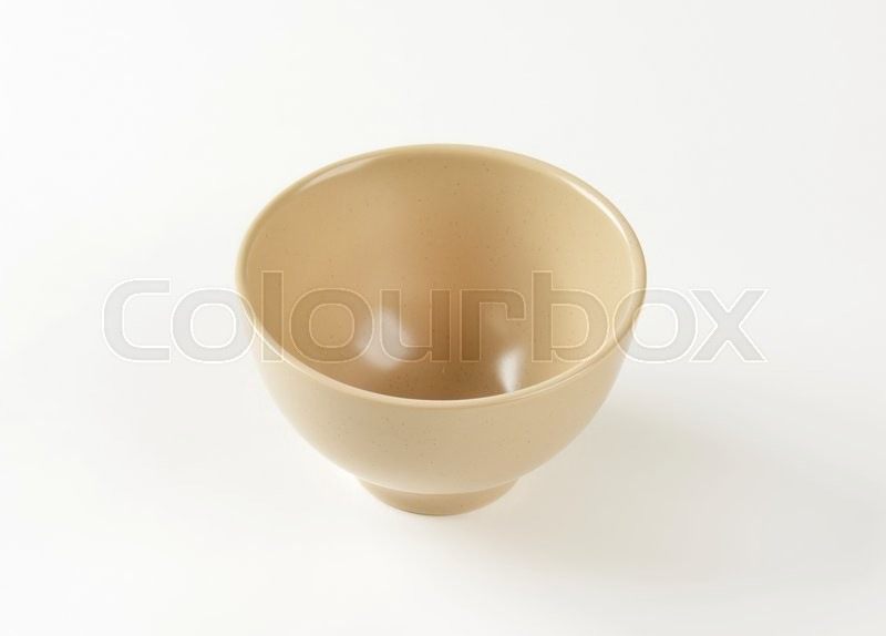 Stock image of 'Empty beige bowl on white background'