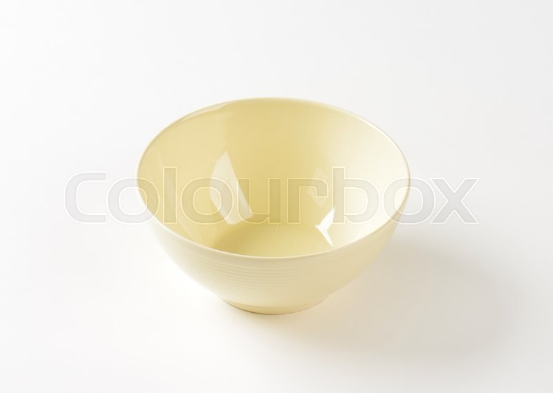 Stock image of 'Deep round cream cereal bowl'