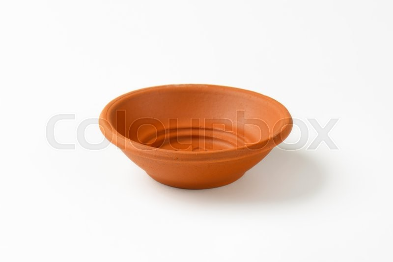 Stock image of 'Empty round red clay bowl'
