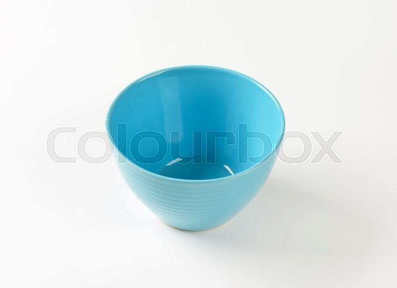 Stock image of 'Empty deep blue snack bowl'