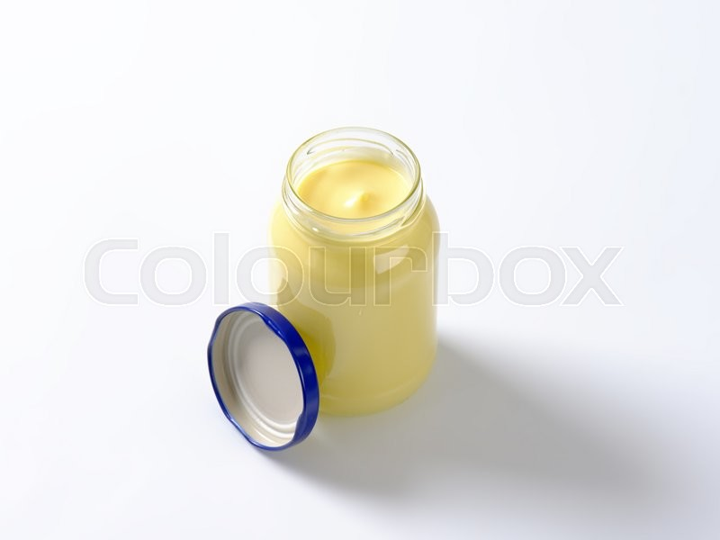 Stock image of 'jar of mayonnaise on white background'