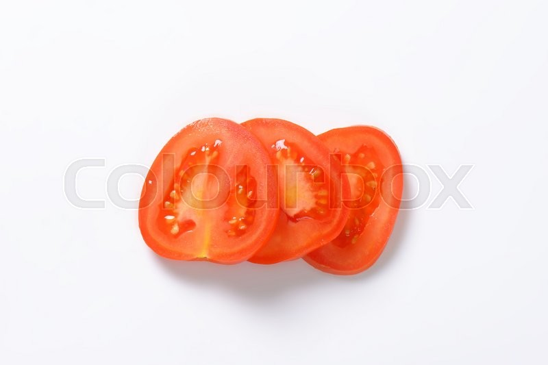 Stock image of 'sliced red tomato on white background'