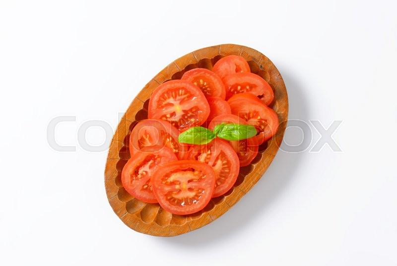 Stock image of 'bowl of tomato slices on white background'