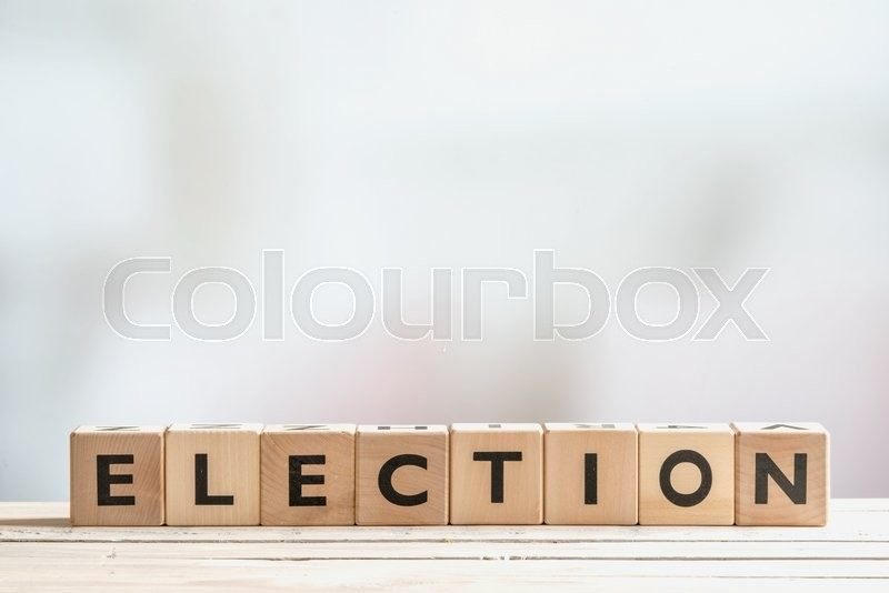 Stock image of 'Election sign made of wooden blocks on a table'
