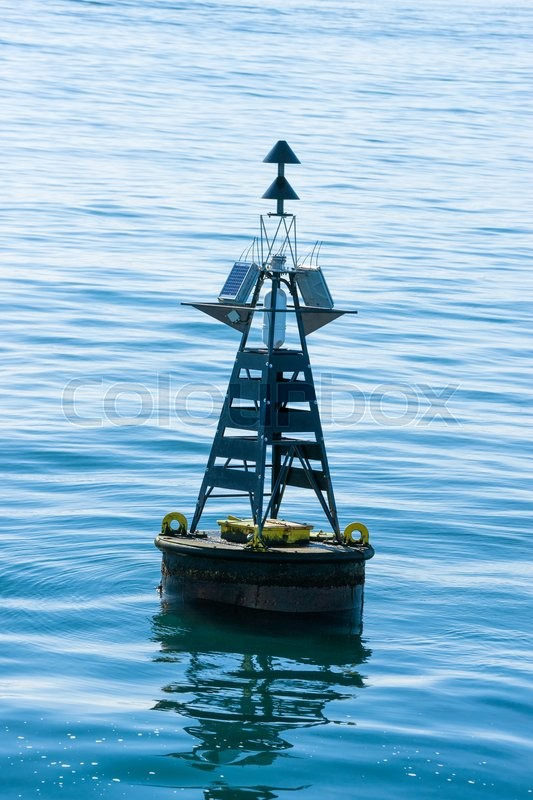 Stock image of 'Close-up of a large buoy in the blue sea'