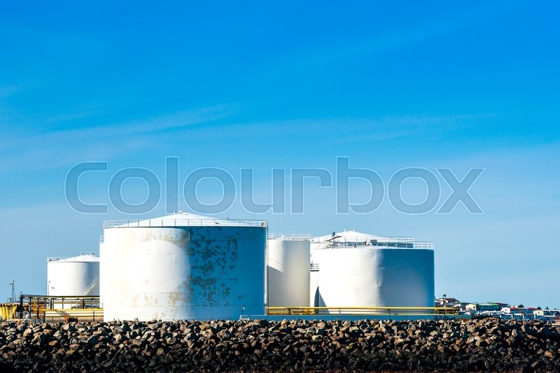 Stock image of 'Storgae silos by the ocean in blue sky'