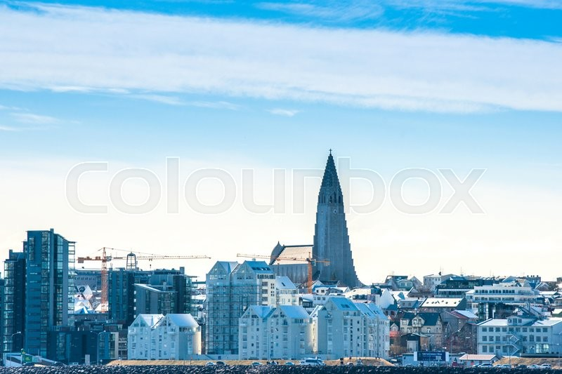 Editorial image of 'Cityscape of Reykjavik with the Hallgrimskirkja in blue sky'