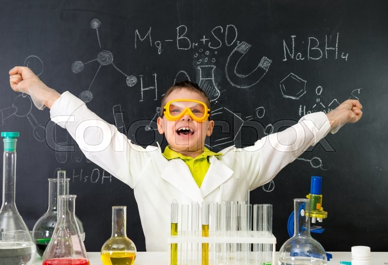 Stock image of 'excited schoolboy with hands up in chemistry lab made a discovery'