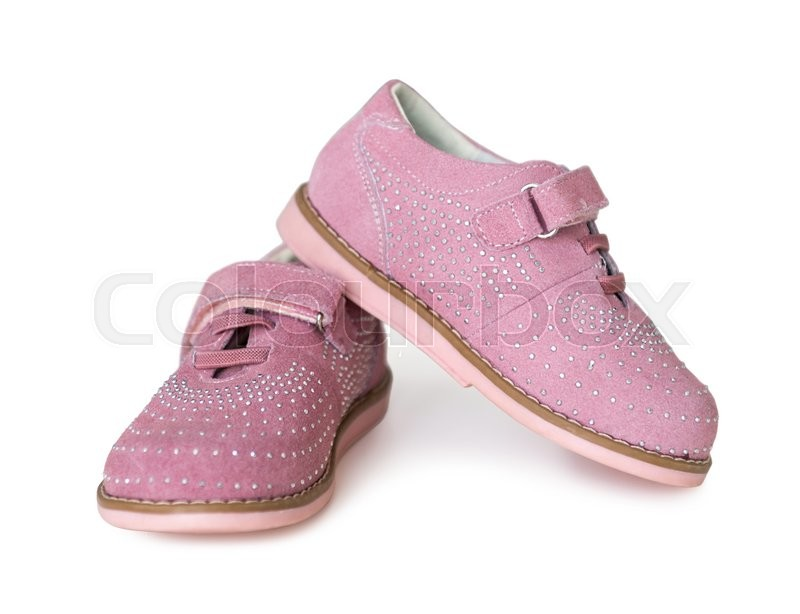 Stock image of 'lovely pink childish shoes with laces and clasp isolated on white background'
