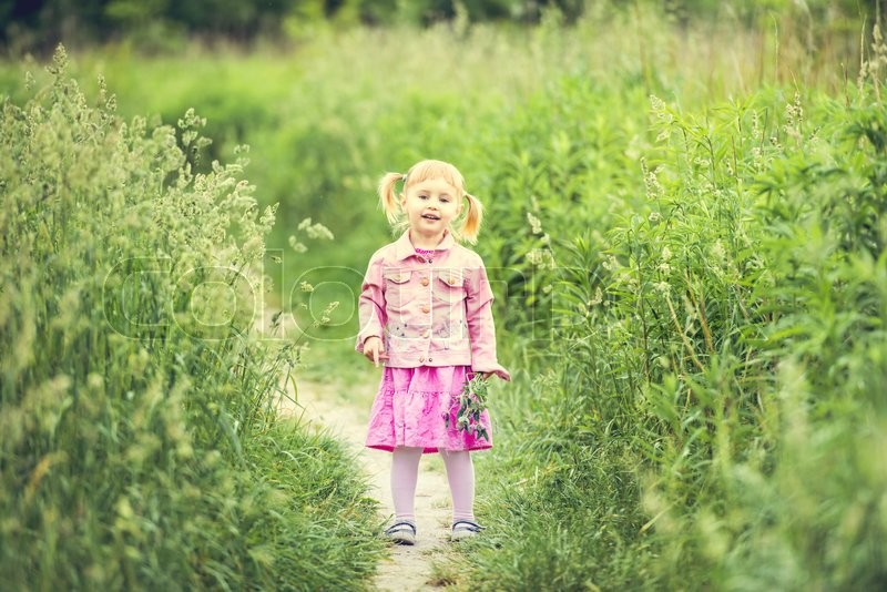 Stock image of 'Cute little girl on the meadow in summer day'