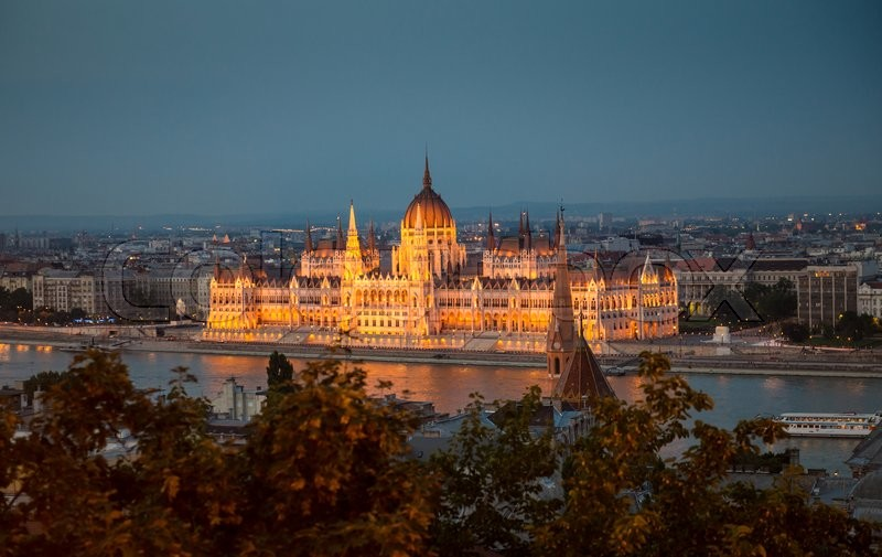 Editorial image of 'illuminated building of the National Hungarian Parliament at night aerial photo'