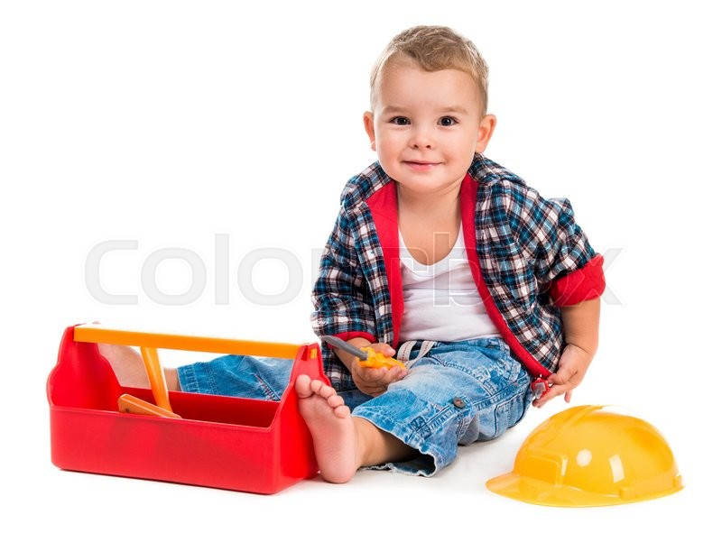 Stock image of 'little boy playing toy tools isolated on white background'