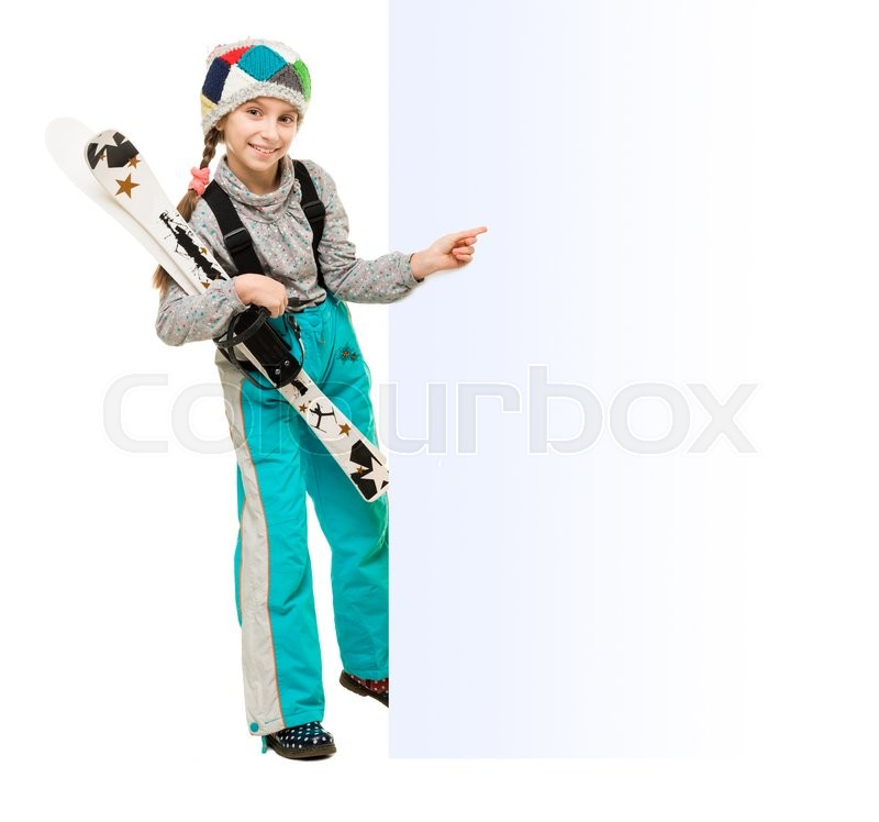 Stock image of 'little girl wih skis pointing at an empty blank isolated on white background'