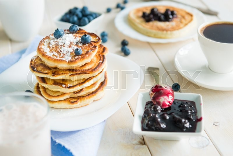 Stock image of 'pancakes with blueberry and jam on white wooden table'