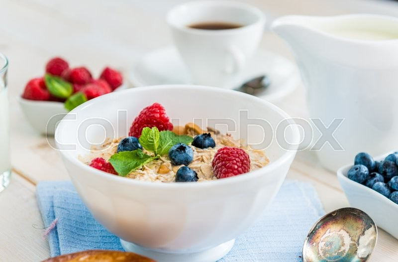 Stock image of 'delicious breakfast with muesli and berries'