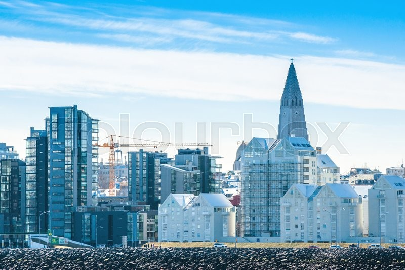 Editorial image of 'REYKJAVIK, ICELAND - APRIL 9 - 2016: Reykjavik cityscape with the Hallgrimskirkja rising up in the city'