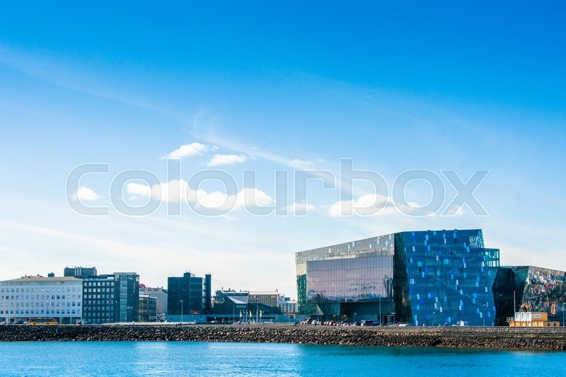 Editorial image of 'REYKJAVIK, ICELAND - APRIL 9 - 2016: Harpa concert hall by the harbor in Reykjavik'