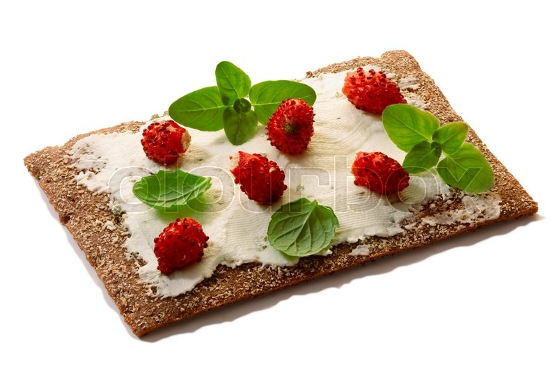 Stock image of 'Bread crisp (crispbread open-faced sandwich) with field strawberries, soft cream cheese, mint and oregano. Clipping paths for both crisp and shadow, infinite depth of field'
