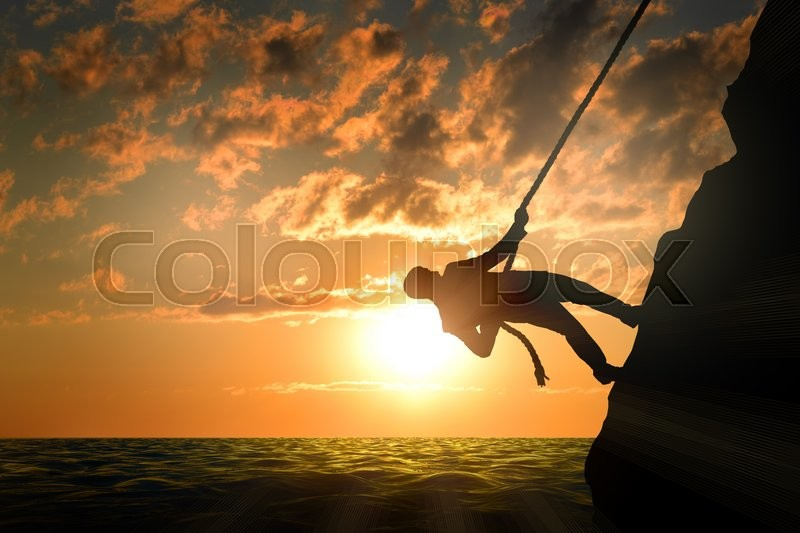 Business man climbs mountain within help of rope, sunset, stock photo