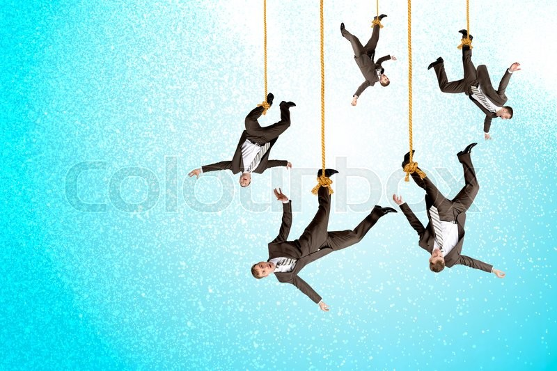 Stock image of 'Businessmen hanging on ropes, place image of your product underneath them'