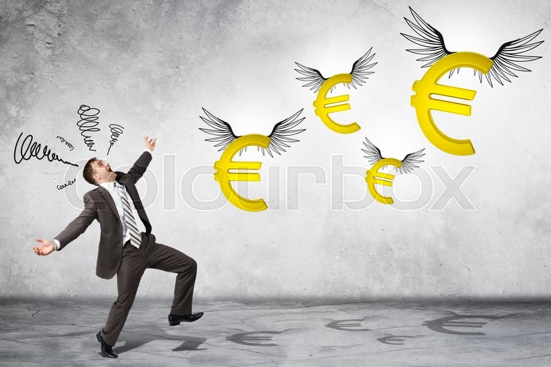 Stock image of 'Surprised business man looking at flying euro signs on grey background'