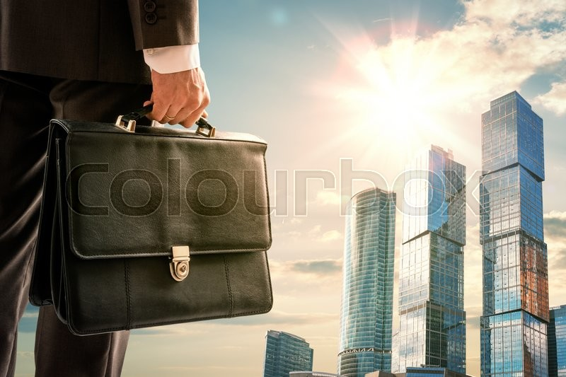 Stock image of 'Man with suitcase looking on city, closeup'