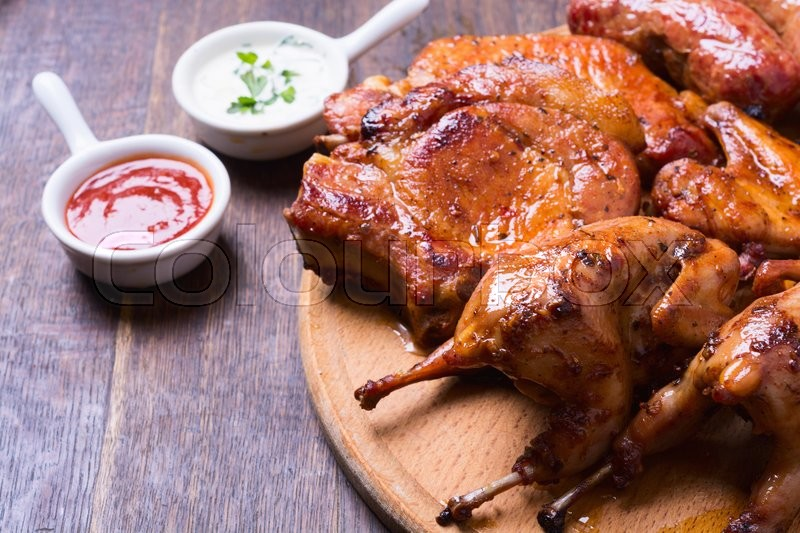 Stock image of 'Baked meat quail on wooden background'