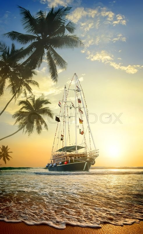Stock image of 'Beautiful ship in ocean near coast with palm trees'