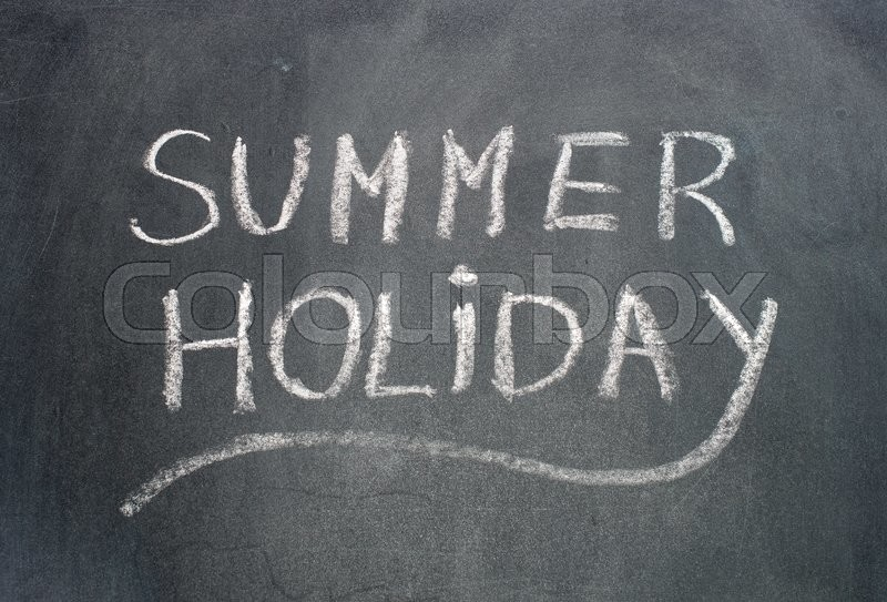 Stock image of 'Summer holiday text on blackboard.'