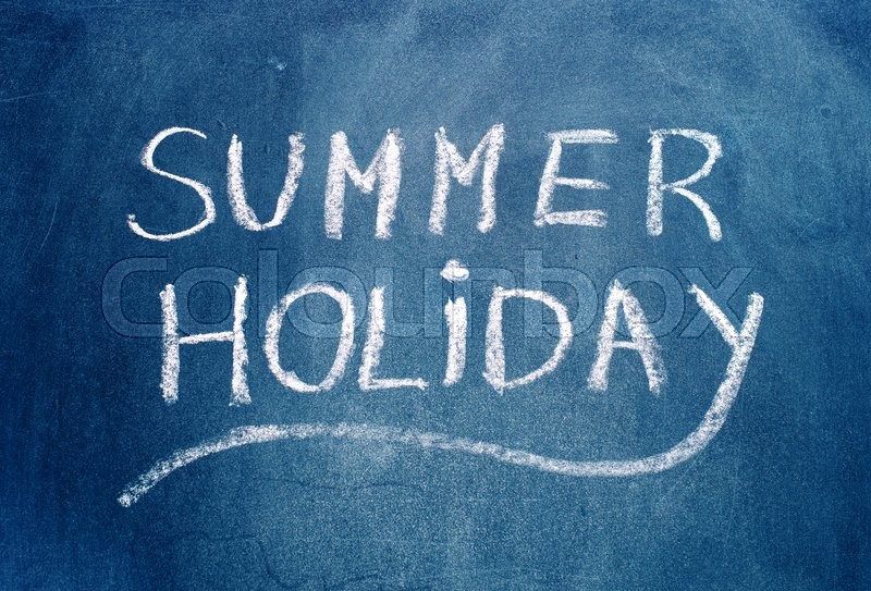 Stock image of 'Summer holiday text on blue chalkboard.'