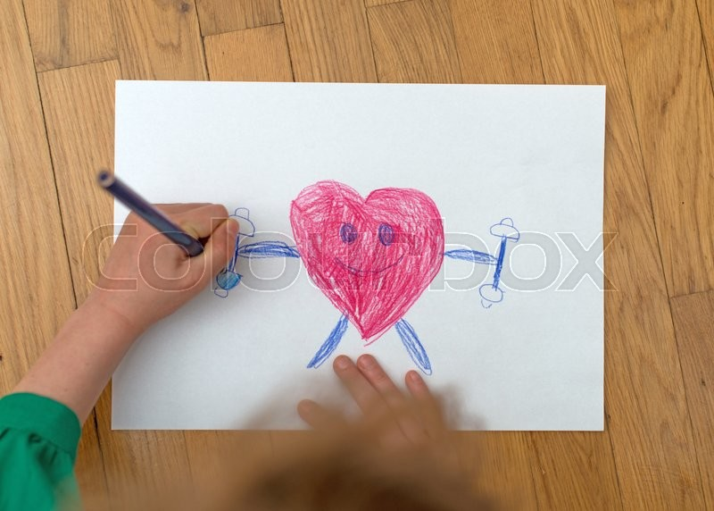 Stock image of 'Child drawing funny sporty red heart on paper.'