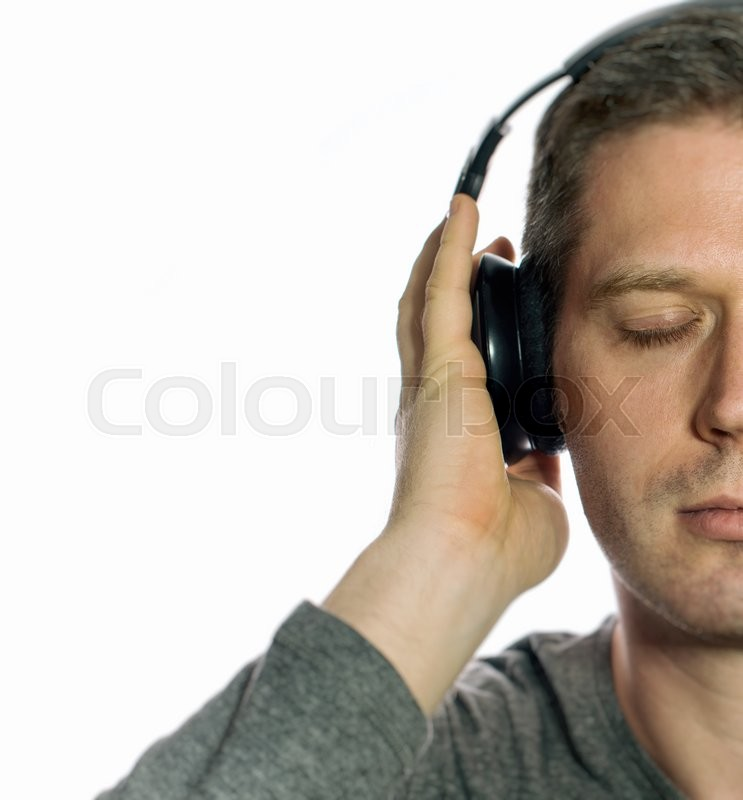 Stock image of 'Man listening to the music in headphones. Isolated on white.'