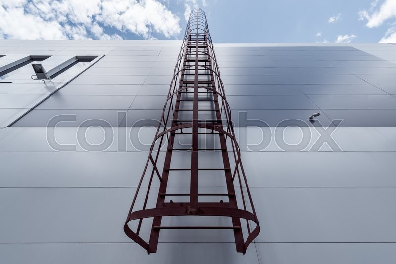 Stock image of 'View of the exterior of the store building with the fire escape.'
