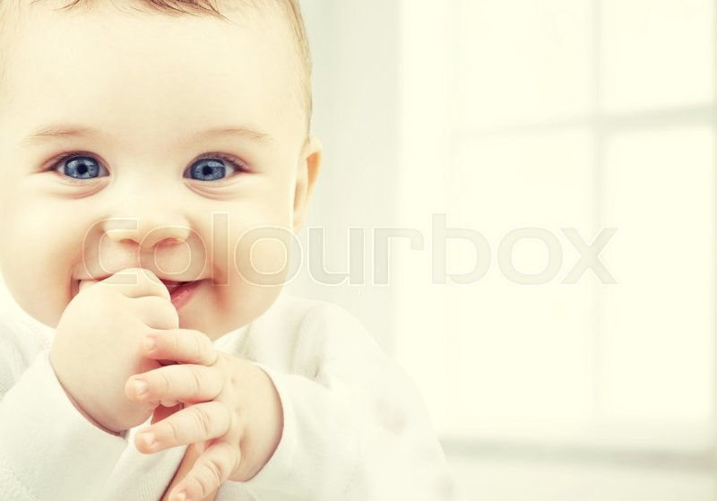 Stock image of 'child, happiness and people concept - adorable baby'
