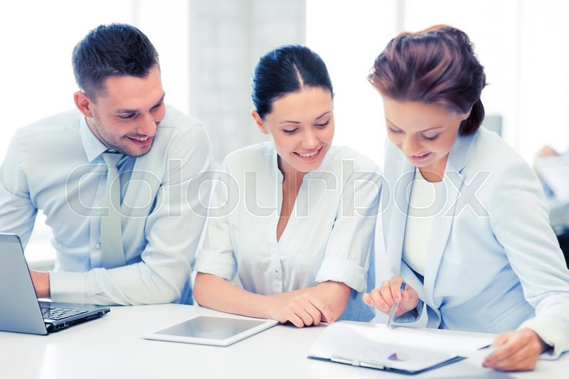 Stock image of 'business team working with tablet pc and laptop in office'