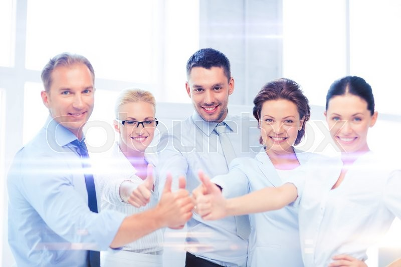 Stock image of 'business and office concept - business team showing thumbs up in office'