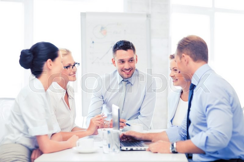 Stock image of 'friendly business team having meeting in office'