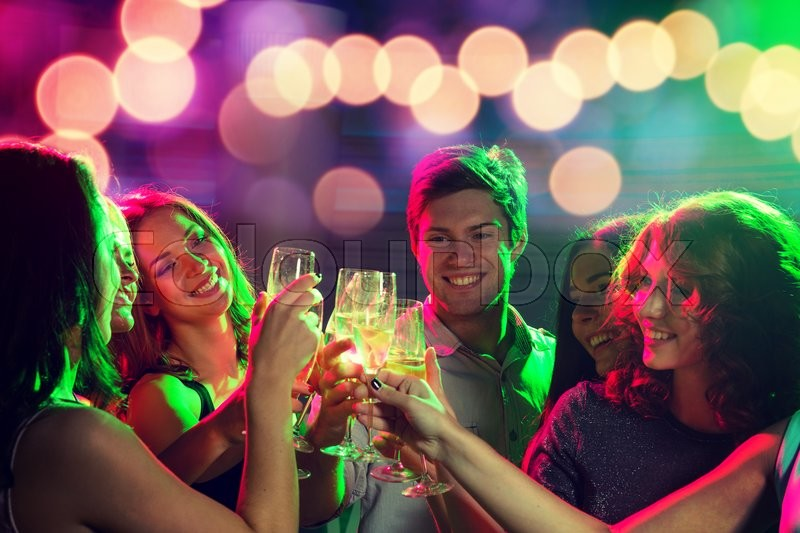 Stock image of 'party, holidays, celebration, nightlife and people concept - smiling friends with glasses of champagne in club'