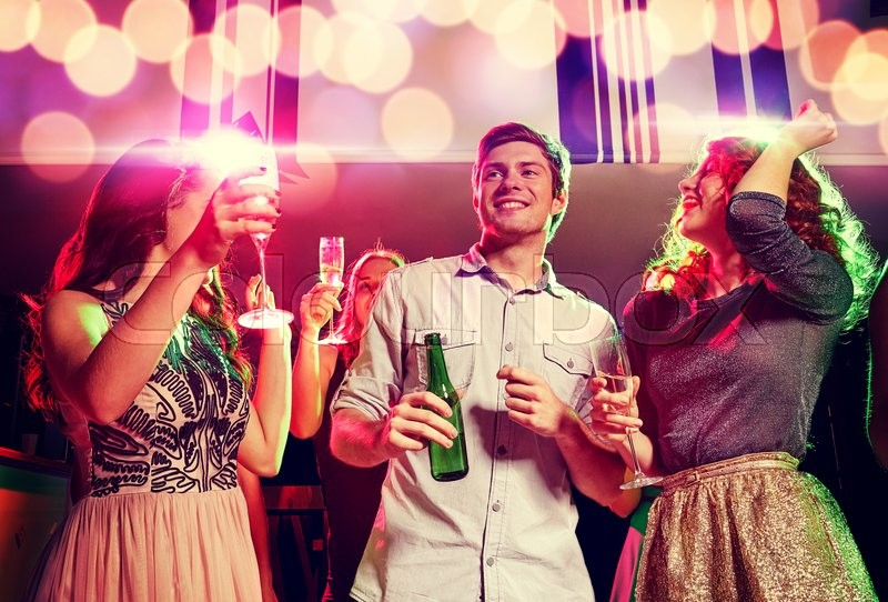 Stock image of 'party, holidays, celebration, nightlife and people concept - smiling friends clinking glasses of champagne and beer in club'
