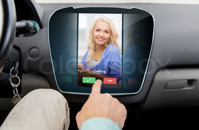 Editorial image of 'transport, driving, technology, communication and people concept - close up of male hand receiving incoming call from phone application on car computer'