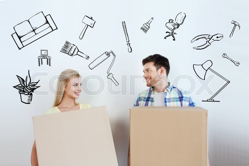 Stock image of 'home, people, repair and real estate concept - smiling couple with big cardboard boxes moving to new place over doodles'