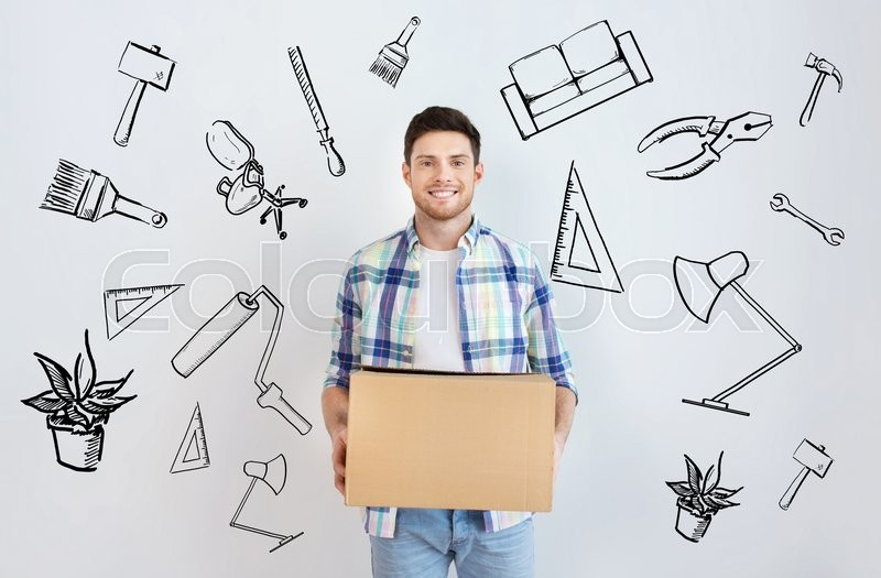 Stock image of 'moving, housing, repair, accommodation and people concept - smiling young man with cardboard box at home over doodles'