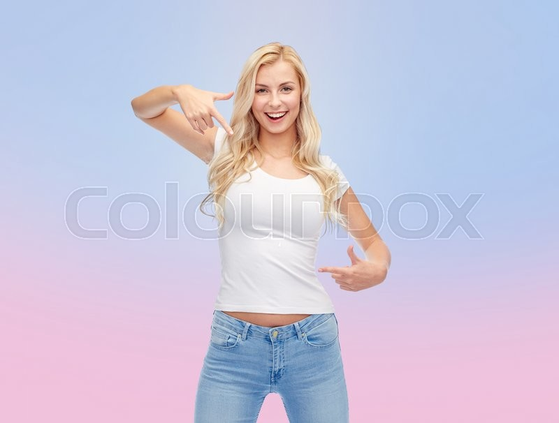 Stock image of 'emotions, expressions, advertisement and people concept - happy smiling young woman or teenage girl in white t-shirt pointing finger to herself over rose quartz and serenity gradient background'