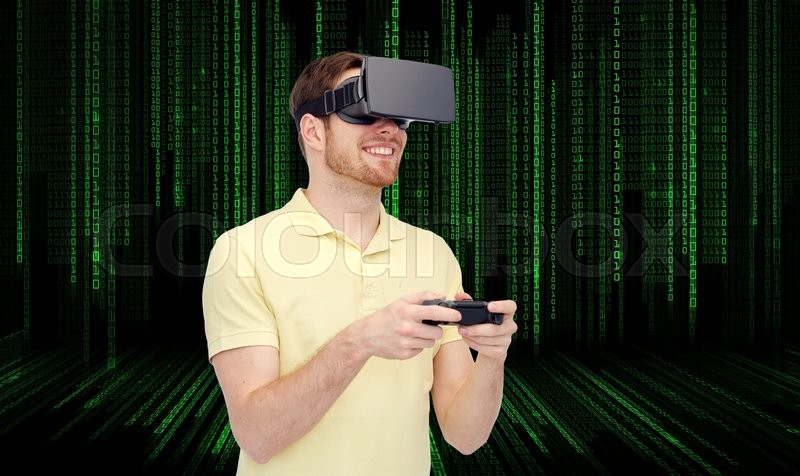 Stock image of '3d technology, virtual reality, entertainment and people concept - happy young man with virtual reality headset or 3d glasses playing with game controller gamepad over binary code background'