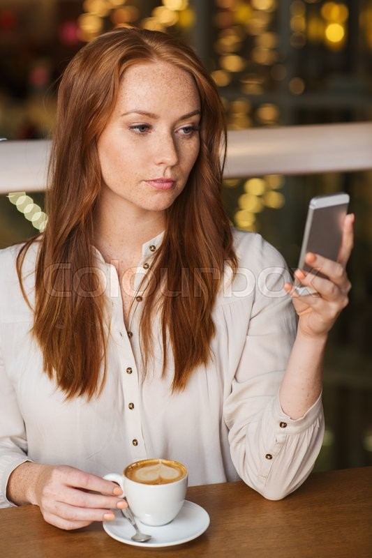 Stock image of 'leisure, technology, lifestyle and people concept - woman with smartphone and coffee at restaurant'