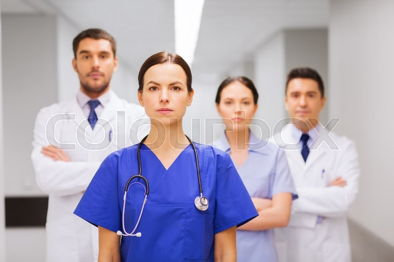 Stock image of 'clinic, profession, people, health care and medicine concept - group of medics or doctors at hospital corridor'