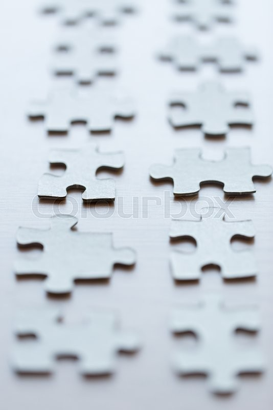 Stock image of 'business and connection concept - close up of puzzle pieces on table'